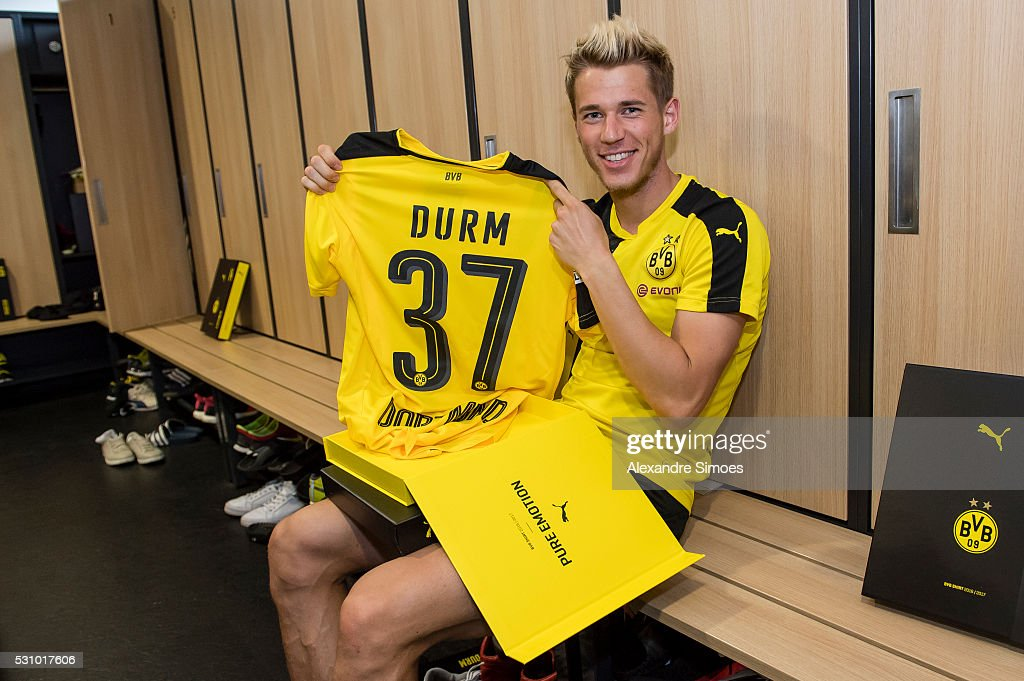 Eric Durm of Borussia Dortmund revealing the new Borussia Dortmund home jersey, Season 2016-2017 on May 12, 2016 in Dortmund, Germany.