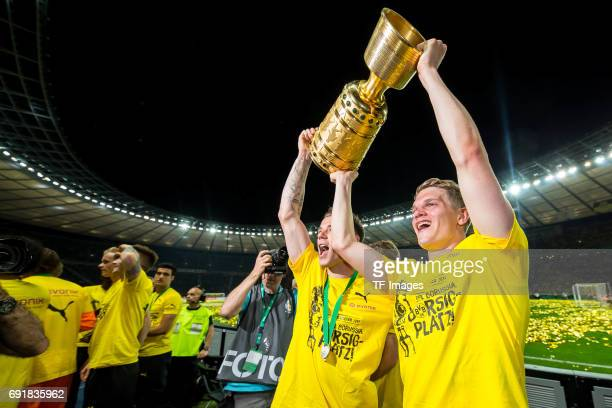 Erik Durm of Dortmund and Matthias Ginter of Dortmund celebrates with the trophy after winning the DFB Cup final match between Eintracht Frankfurt...