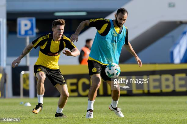Erik Durm of Dortmund and Oemer Toprak of Dortmund battle for the ball during the Borussia Dortmund training camp at Marbella Football Center on...