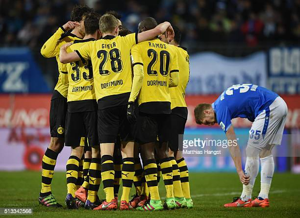 Erik Durm of Dortmund celebrates with his teammates after scoring his team's second goal during the Bundesliga match between SV Darmstadt 98 and...