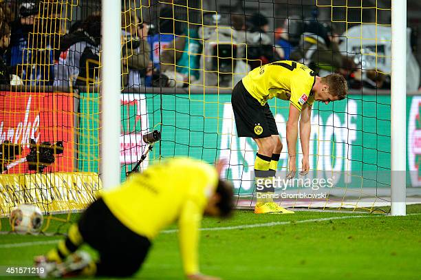 Eric Durm of Dortmund looks dejected after the second Munich goal scored by Arjen Robben during the Bundesliga match between Borussia Dortmund and FC...