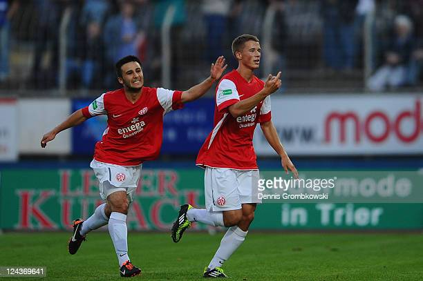 Erik Durm of Mainz celebrates with team mates after scoring his team's opening goal during the Regionalliga West match between SV Eintracht Trier 05...