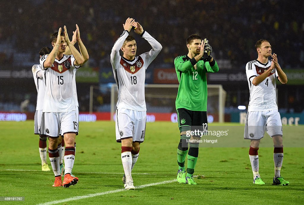 Erik Durm, Toni Kroos, Ron-Robert Zieler and Benedikt Hoewedes of Germany thank the fans for their support during the International Friendly match between Spain and Germany at Estadio Balaidos on November 18, 2014 in Vigo, Spain.