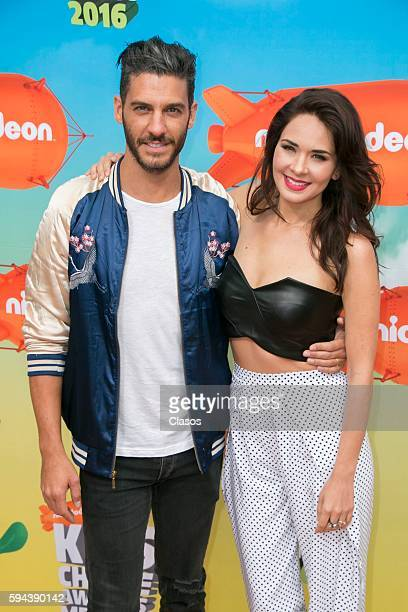 Erik Elias and Adriana Louvier poses for pictures during the Kids Choice Awards Mexico 2016 Red Carpet at Auditorio Nacional on August 20 206 in...
