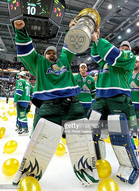 Erik Ersberg and Vitaly Kolesnik of the Salavat Yulaev Ufa hoist the Gagarin Cup after the Salavat Yulaev Ufa defeated the Atlant Mytishchi 32 and...