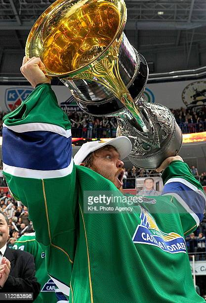Erik Ersberg of the Salavat Yulaev Ufa hoists the Gagarin Cup after the Salavat Yulaev Ufa defeated the Atlant Mytishchi 32 and won the Gagarin Cup...