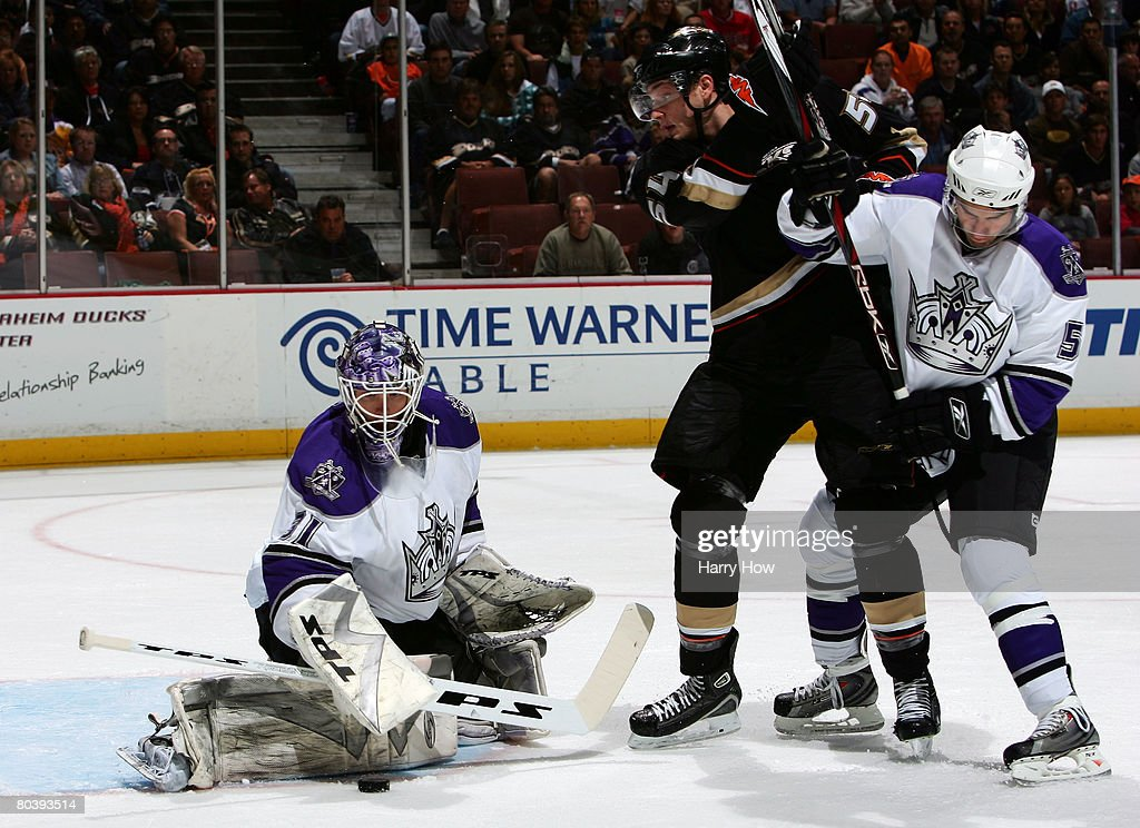Erik Erserg #31 of the Los Angeles Kings makes a save as Robby Ryan #54 of the Anaheim Ducks is tied up by Peter Harold #5 of the Los Angeles Kings during the period at the Honda Center on March 26, 2008 in Anaheim, California.