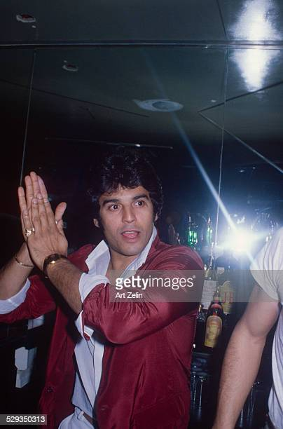 Erik Estrada in a red silk jacket in a bar circa 1970 New York