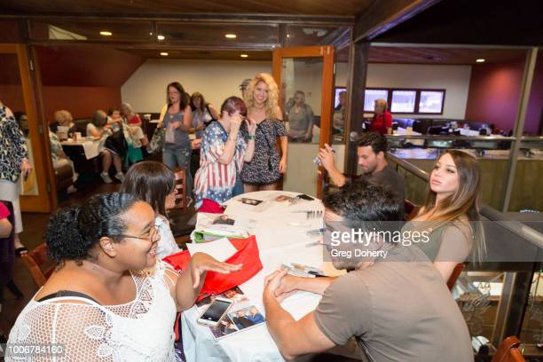 Erik Fewllows Celeste Andrews and Brandon Beemer meet and greet fans at The Bay Cast Host Fan Appreciation Event on July 27 2018 in Glendale...