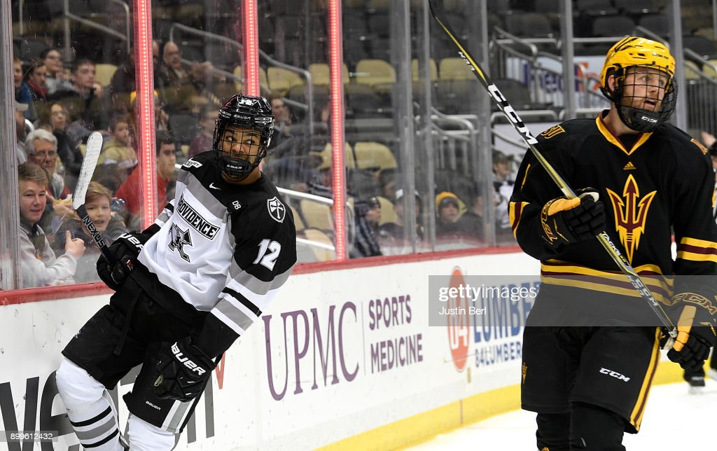 Erik Foley #12 of the Providence Friars reacts after scoring a goal in the first period during the game against the Arizona State Sun Devils at PPG PAINTS Arena on December 29, 2017 in Pittsburgh, Pennsylvania.