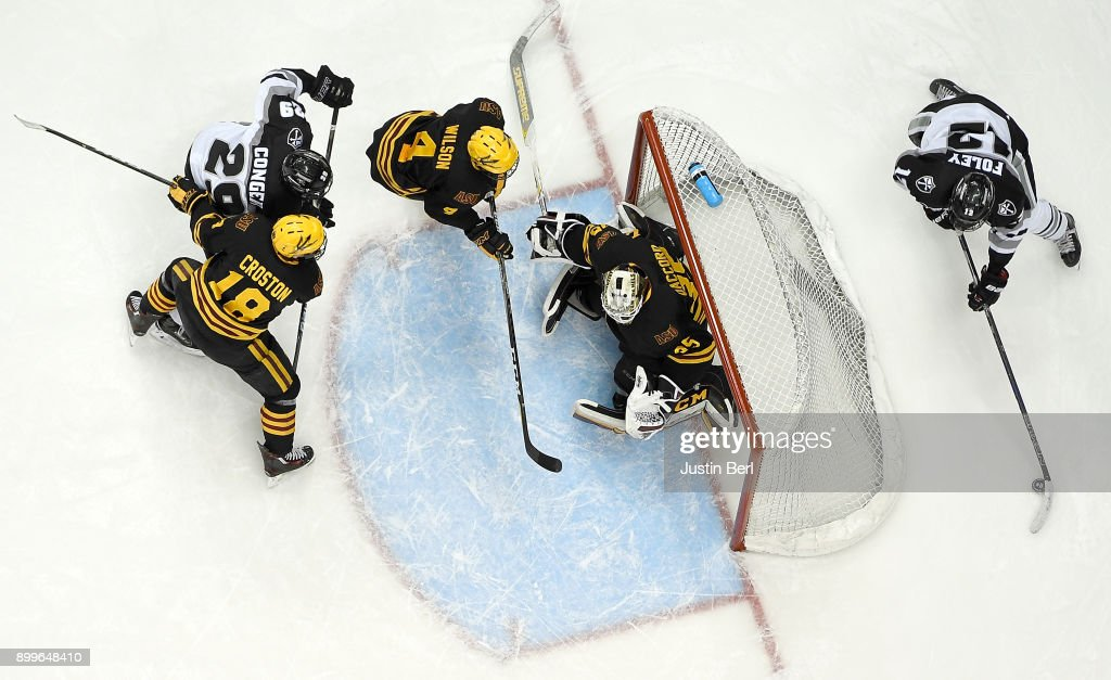 Erik Foley #12 of the Providence Friars skates with the puck in the offensive zone in the first period during the game against the Arizona State Sun Devils at PPG PAINTS Arena on December 29, 2017 in Pittsburgh, Pennsylvania.