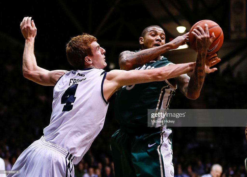 Erik Fromm #4 of the Butler Bulldogs and Chris Braswell #35 of the Charlotte 49ers battle for a rebound at Hinkle Fieldhouse on February 13, 2013 in Indianapolis, Indiana. Charlotte defeated Butler 71-67.