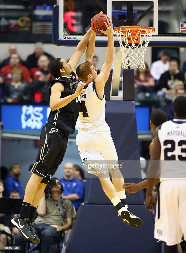 Erik Fromm #4 of the Butler Bulldogs dunks the ball while defended by A. J. Hammons #20 of the Purdue Boilermakers during the 2013 Crossroads Classic at Bankers Life Fieldhouse on December 14, 2013 in Indianapolis, Indiana.