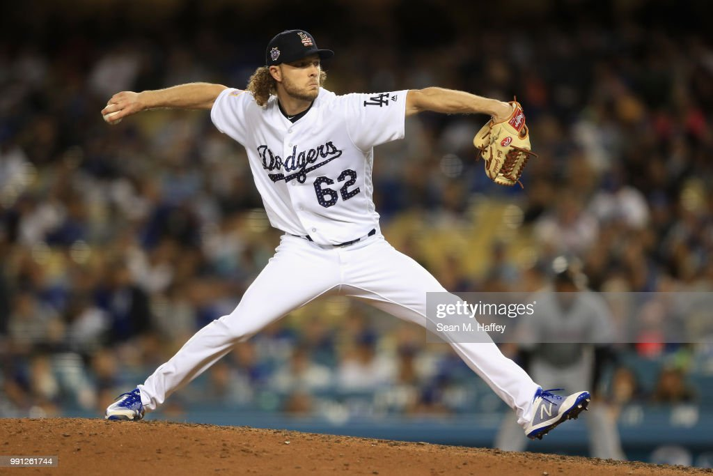 Erik Goeddel #62 of the Los Angeles Dodgers pitches during the ninth inning of a game against the Pittsburgh Pirates at Dodger Stadium on July 3, 2018 in Los Angeles, California.