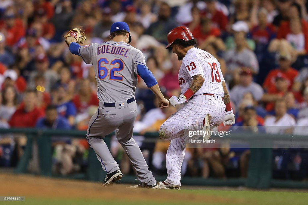 Erik Goeddel #62 of the New York Mets beats Freddy Galvis #13 of the Philadelphia Phillies to the bag for a force out in the eighth inning during a game at Citizens Bank Park on July 16, 2016 in Philadelphia, Pennsylvania. The Phillies won 4-2.