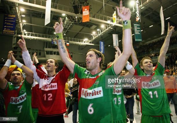 Erik Goethel Silvio Heinevetter Grzegorz Tkaczyk and Christian Sprenger of Magdeburg celebrate after the Handball Bundesliga match between SC...