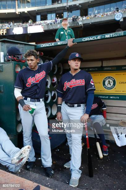 Erik Gonzalez and Giovanny Urshela of the Cleveland Indians stand in the dugout prior to the game against the Oakland Athletics at the Oakland...