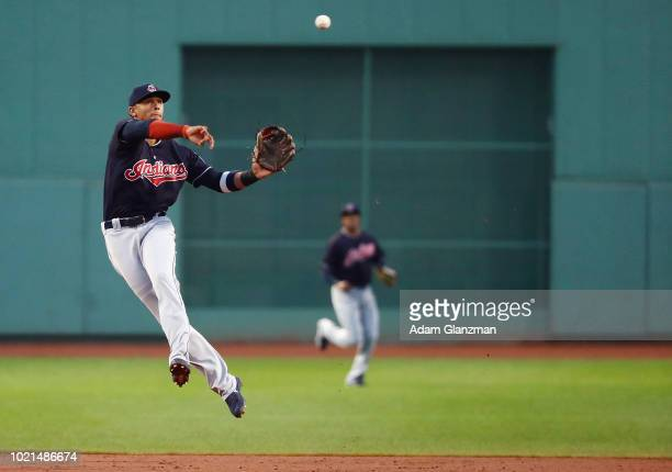 Erik Gonzalez of the Cleveland Indians makes a throw to first base in the first inning of a game against the Boston Red Sox at Fenway Park on August...
