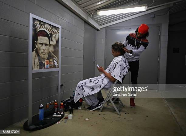 Erik Gonzalez of the Cleveland Indians sits in a tunnel for a haircut from Memim of Chicago IL at Guaranteed Rate Field before the Indians take on...