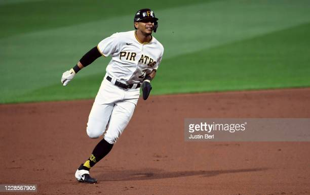 Erik Gonzalez of the Pittsburgh Pirates advances to third base on a double by Gregory Polanco in the second inning during the game against the St....