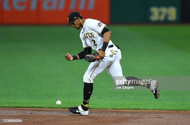 Erik Gonzalez of the Pittsburgh Pirates bobbles a ball hit by Matt Wieters of the St. Louis Cardinals during the third inning of game two of a...