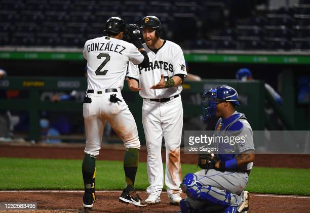 Erik Gonzalez of the Pittsburgh Pirates celebrates his two run home run with Todd Frazier during the fourth inning against the Kansas City Royals at...