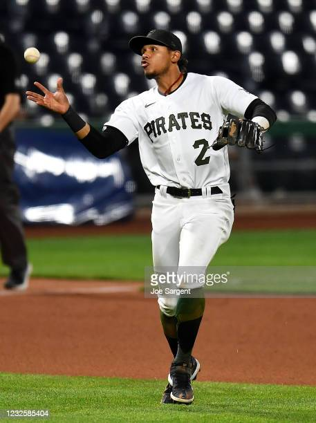 Erik Gonzalez of the Pittsburgh Pirates fails to field a ball hit by Hanser Alberto of the Kansas City Royals during the seventh inning at PNC Park...