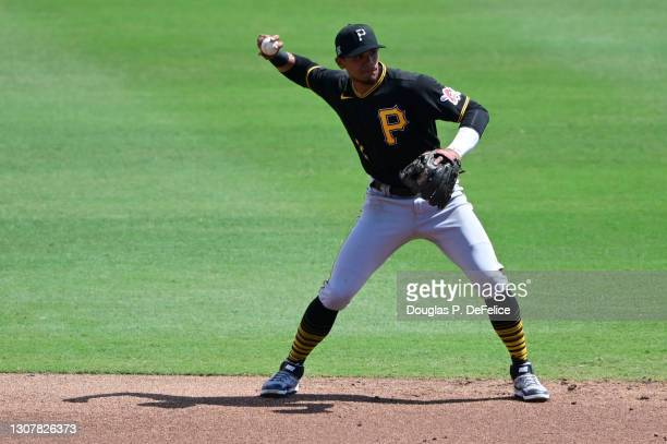 Erik Gonzalez of the Pittsburgh Pirates fields the ball during the first inning against the Baltimore Orioles during a spring training game at Ed...