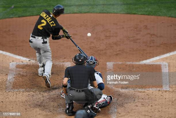 Erik Gonzalez of the Pittsburgh Pirates hits an RBI double against the Minnesota Twins during the fourth inning of the game at Target Field on August...