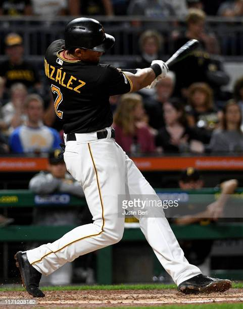Erik Gonzalez of the Pittsburgh Pirates hits an RBI double in the fourth inning during the game against the Chicago Cubs at PNC Park on September 25,...