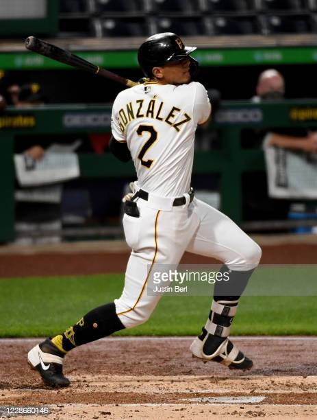 Erik Gonzalez of the Pittsburgh Pirates hits an RBI double to right field in the second inning during the game against the Chicago Cubs at PNC Park...