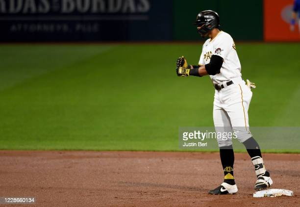Erik Gonzalez of the Pittsburgh Pirates reacts after hitting an RBI double to right field in the second inning during the game against the Chicago...