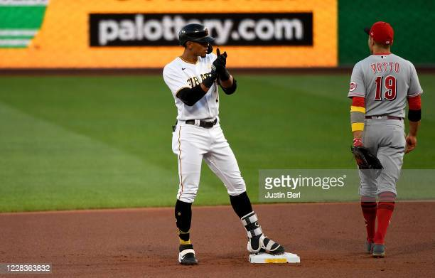 Erik Gonzalez of the Pittsburgh Pirates reacts at second base after hitting a double in the first inning during the game against the Cincinnati Reds...
