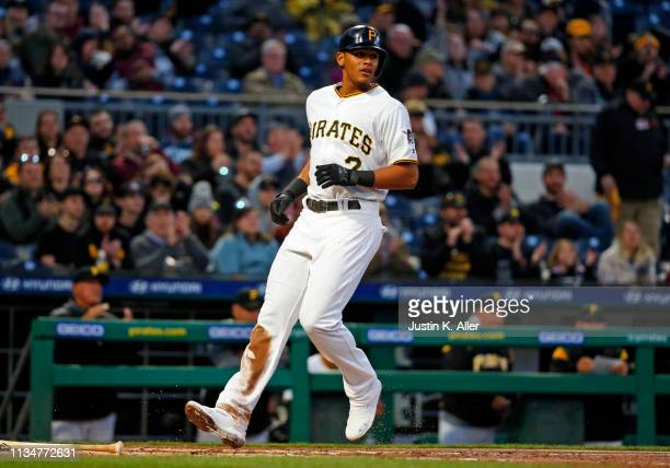 Erik Gonzalez of the Pittsburgh Pirates scores on an RBI single in the second inning against the St. Louis Cardinals at PNC Park on April 3, 2019 in...