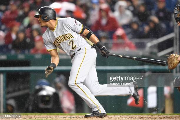 Erik Gonzalez of the Pittsburgh Pirates takes a swing during a baseball game against the Washington Nationals at Nationals Park on April 12, 2019 in...