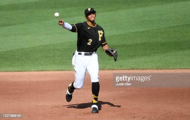 Erik Gonzalez of the Pittsburgh Pirates throws to first base to force out JaCoby Jones of the Detroit Tigers in the third inning during the game at...