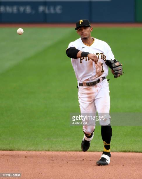 Erik Gonzalez of the Pittsburgh Pirates throws to first base to force out Kris Bryant of the Chicago Cubs in the fifth inning during the game at PNC...