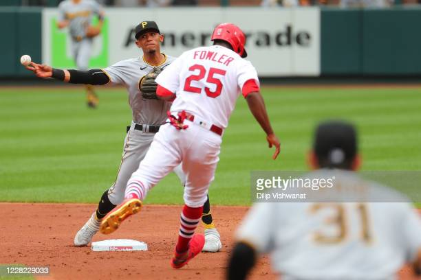 Erik Gonzalez of the Pittsburgh Pirates turns a double play against the St. Louis Cardinals in the third inning of a doubleheader at Busch Stadium on...