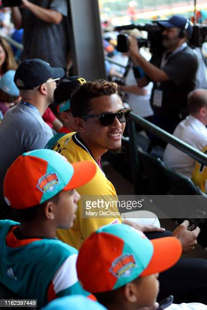 Erik Gonzalez of the Pittsburgh Pirates watches the Little League World Series with members of the Latin America Team at Howard J. Lamade Stadium...