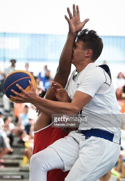 Erik Groznik of Slovenia receives a foul in the Men´s Semifinal game during Day 11 of Buenos Aires 2018 Youth Olympic Games at Urban Park Puerto...