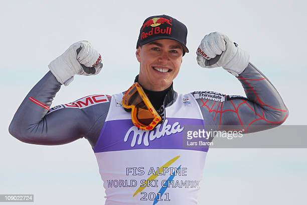 Erik Guay of Canada celebrates at the flower ceremony after winning the Men's Downhill during the Alpine FIS Ski World Championships on the Kandahar...