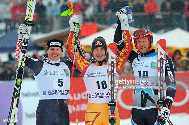 Erik Guay of Canada with Ivica Kostelic and Aksel Lund Svindal takes the globe for the overall World Cup Super G during the Audi FIS Alpine Ski World...