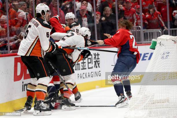 Erik Gudbranson and Brendan Guhle of the Anaheim Ducks fight with Brendan Leipsic of the Washington Capitals in the second period at Capital One...