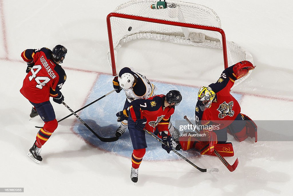 Erik Gudbranson #44 and Dmitry Kulikov #7 of the Florida Panthers look towards the net as the puck shot by Nathan Gerbe #42 (not pictured) of the Buffalo Sabres scores past goaltender Scott Clemmensen #30 in the first period at the BB&T Center on February 28, 2013 in Sunrise, Florida. The Sabres defeated the Panthers 4-3 in a shootout.