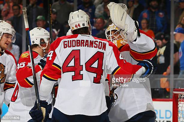Erik Gudbranson and Roberto Luongo of the Florida Panthers celebrate their win over the New York Islanders in Game Four of the Eastern Conference...
