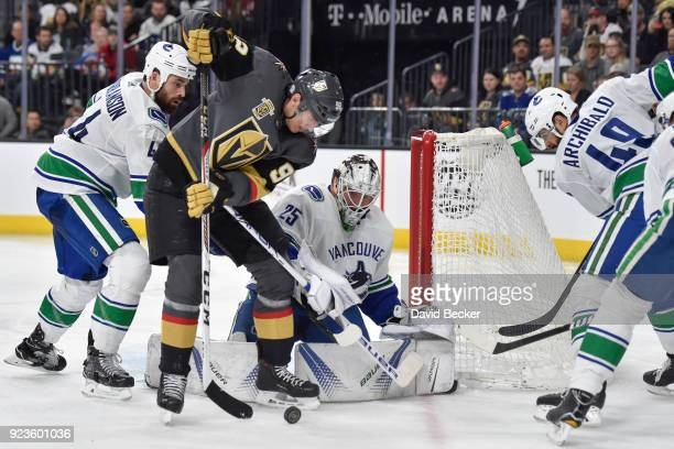 Erik Gudbranson Darren Archibald and goalie Jacob Markstrom of the Vancouver Canucks defend their goal against Tomas Nosek of the Vegas Golden...