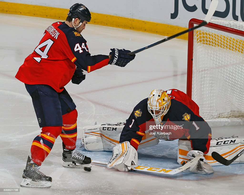 Erik Gudbranson #44 looks down as goaltender Roberto Luongo #1 of the Florida Panthers defends the net against the Ottawa Senators at the BB&T Center on December 8, 2015 in Sunrise, Florida. The Senators defeated the Panthers 4-2.