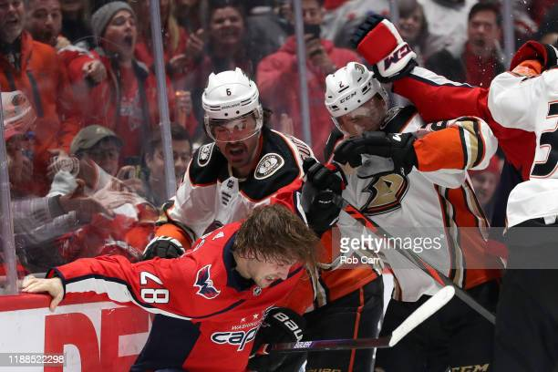 Erik Gudbranson of the Anaheim Ducks and Brendan Leipsic of the Washington Capitals fight in the second period at Capital One Arena on November 18...