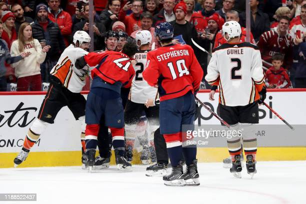 Erik Gudbranson of the Anaheim Ducks punches Garnet Hathaway of the Washington Capitals in the second period at Capital One Arena on November 18 2019...