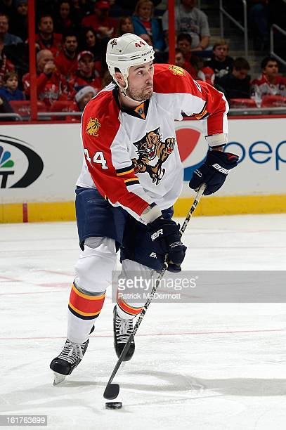 Erik Gudbranson of the Florida Panthers brings the puck up ice during an NHL hockey game against the Washington Capitals at Verizon Center on...